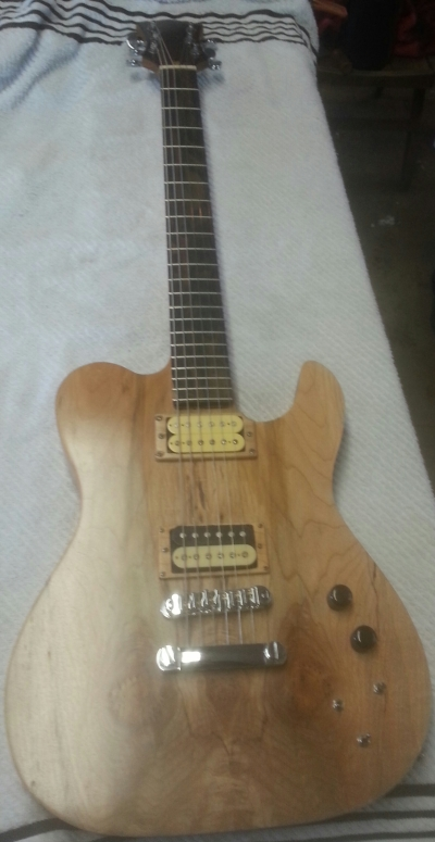 Natural finish Tele-style guitar with dual humbuckers